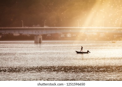Going fishing under the bridge in the morning sun at Lake Kawaguchi, one of the scenic Fuji Five Lakes at Fujikawaguchiko in the northern foothills of Mount Fuji, Japan.
