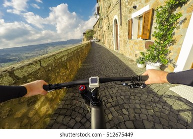 Going on bicycle in Umbria Orvieto tipical Italian town. Original point of view