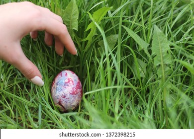 Going on easter hunt and kids gathering eggs in the garden. Easter holidays in Christianity