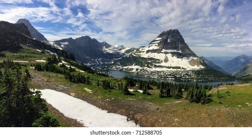 Going to the Sun Road, View of Landscape, snow fields In Glacier National Park around Logan Pass, Hidden Lake, Highline Trail, which features waterfalls, wildlife, and is surrounded by mountains
