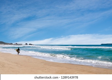 Going Surfing on Joaquina beach in Florianopolis, Brazil