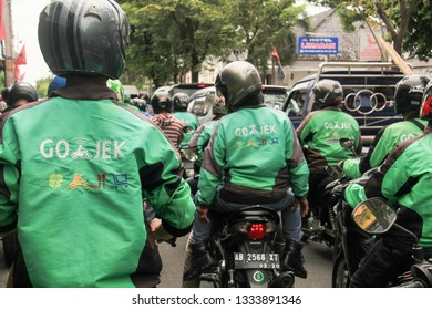 go-jek at yogyakarta, indonesia on march 8 2019. the demonstration of the go-jek drivers refused the policy of tariff cuts per kilometer