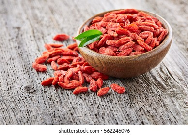 Goji berries on a wooden background