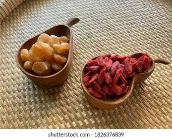 Goji berry and longan in a wooden cups