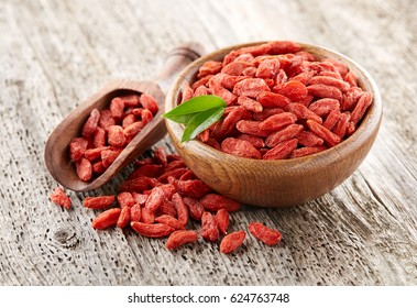 Goji berry on a wooden background