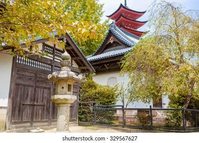 Goju-no-to pagoda of Itsukushima Shrine on a rainy day, Miyajima, Japan.