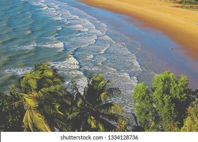 Gokarna Beach, Karnataka. Top view of the palm tree and the beach.
