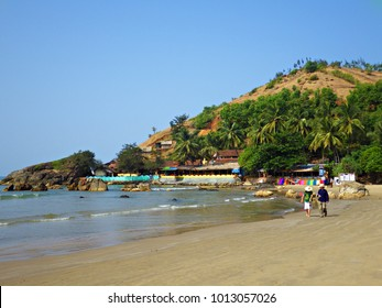Gokarna, India - January 2015: Beach walk in Gokarna, Karnataka, India People walking along the beach in Gokarna, India