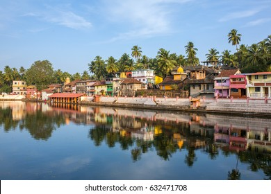 Gokarna, India - January 22, 2016: Colorful indian houses on the bank of sacred lake Koti Teertha in Gokarna, India.