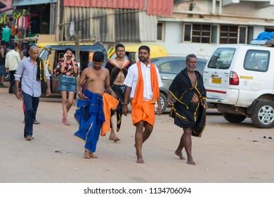 Gokarna, India - July 8, 2018 - Pilgrims typical traffic situation on indian street in Gokarna
