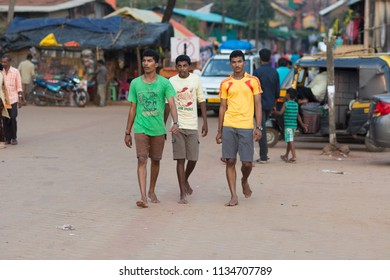 Gokarna, India - July 8, 2018 - Young men in typical traffic situation on indian street in Gokarna