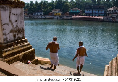 Gokarna, India - November 6, 2016: Unidentified hindu piligrims standing on the bank of the sacred lake in Gokarna. The city is a holy pilgrimage site for Hinduists