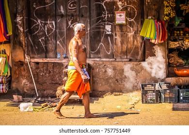 Gokarna Karnataka India 10-30-2017 Unknown man walking in main street of Gokarna in the morning