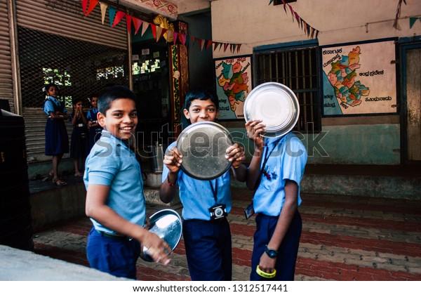 Gokarna Karnataka India February 13, 2019 Closeup of Indian children in blue shirt having fun at Gokarna City School in the morning