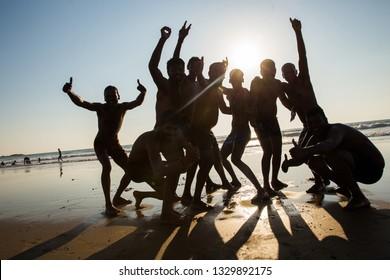 Gokarna,  Karnataka , India. February 18,  2019 .  Joyful indian Youth on beach in Gokarna -  symbol of  young India