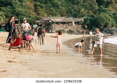 Gokarna Karnataka India January 24, 2019 View of a orthodox Israeli family and kids in holiday in OM beach in the evening
