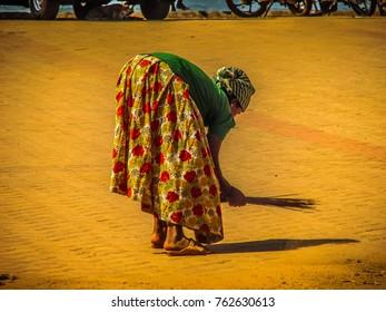 Gokarna Karnataka India November 22-2017 Unknown people low caste cleaning the street