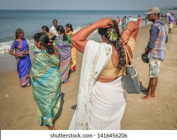 GOKARNA,KARNATAKA/ INDIA-FEBUARY 1st, 2018: Indian tourists visiting the main beach of Gokarna. Many people come to worship at an important temple here.