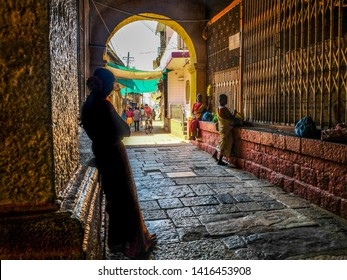 GOKARNA,KARNATAKA/ INDIA-FEBUARY 5TH, 2018: Inside Mahabaleshwar Temple.Several women sell flowers and other offerings to temple visitors,used for holy offerings.