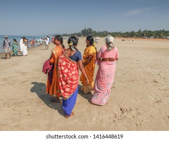Gokarna,Karnataka/India-Febuary 1st, 2018:  Female Indian tourists visiting the main beach of Gokarna. Many people come to worship at an important temple here.