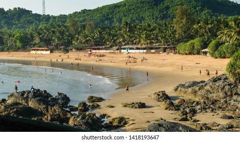 GOKARNA,KARNATAKA/INDIA-FEBUARY 2ND 2018: Holidaymakers and travellers enjoying the sun,sea and leisure activities at this increasingly popular beach in India.