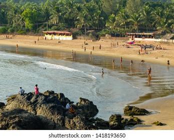 GOKARNA,KARNATAKA/INDIA-FEBUARY 2ND 2018: Tourists and travellers enjoying the sun,sea and leisure activities at this increasingly popular beach in India. IIndiauthwestern India.