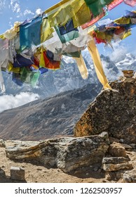 GOKYO, NEPAL - OCTOBER 19, 2012: Traditional Nepalese flags to the Renjo Pass (5360 m) - Everest region, Gokyo valley, Nepal, Himalayas
