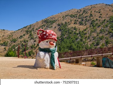 GOLAN HEIGHTS, ISRAEL - AUGUST 5, 2017: Big sculpture of snowman at ski resort area on Mount Hermon, a view at summer day.