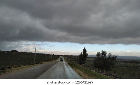 Golan Highland on December 24, 2018: cloudy and stormy sky was above the road