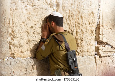 Golani Soldier praying at the Wailing Wall with weapon, Jerusalem, Israel