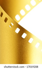 Gold 35 mm film macro isolated over white background