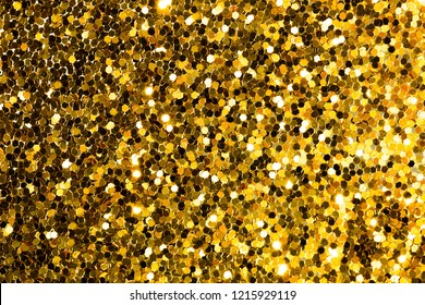 Gold abstract background with bokeh, defocused christmas lights. Festive concept. Top view.