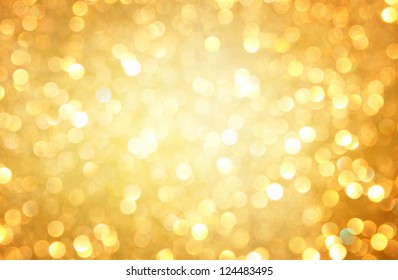 gold abstract background with bokeh defocused lights