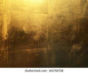 Gold abstract background with color shift from light to dark.