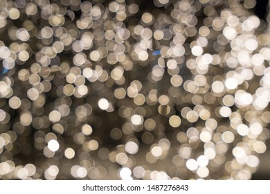 Gold abstract bokeh background. Defocused glitter lighting image for art and design.