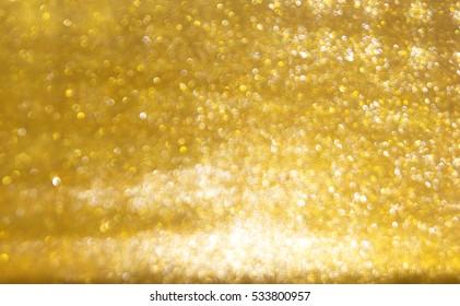 Gold abstract bokeh background/Abstract circular bokeh background gold.