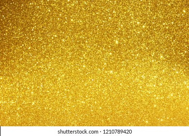 gold abstract bokeh glitter texture background, filled with shiny gold glitter background
