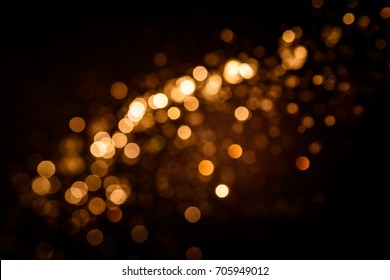 Gold abstract bokeh on black background