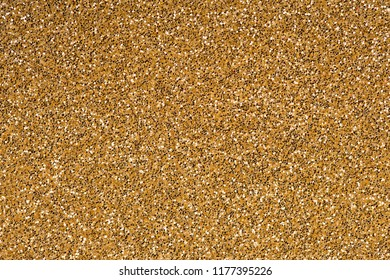 Gold abstract glitter background, close up