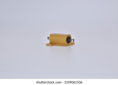 Gold Aluminum Shell Resistance Aluminum Shell Case Wirewound Resistor.Gold Tone Aluminum Electrical Resistance with a high power, and high temperature resistant Isolated on white background.