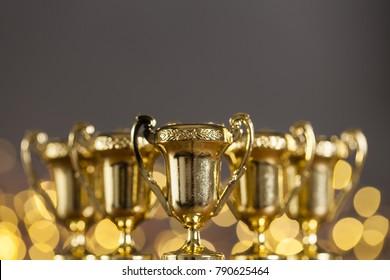 Gold award trophy against bright blurred lights