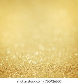 Gold background glitter light abstract. Silver golden yellow festive for christmas.