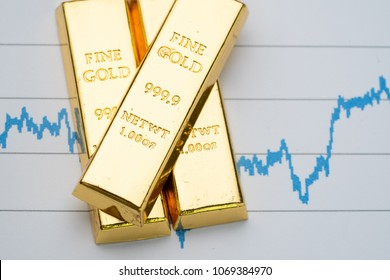 Gold bar, bullion stack on rising price graph as financial crisis or war safe haven, financial asset, investment and wealth concept.