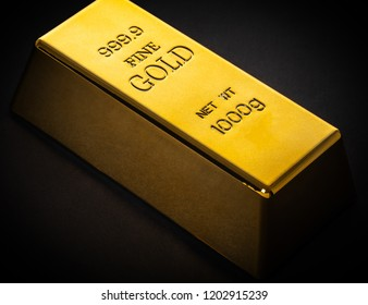 gold bar close-up on a black background