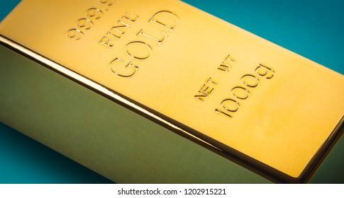 gold bar closeup on blue background
