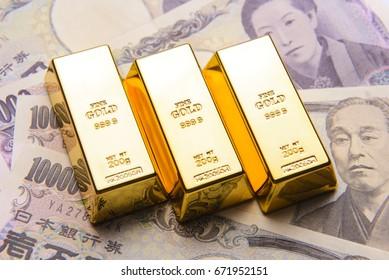 Gold bar with japanese yen bills