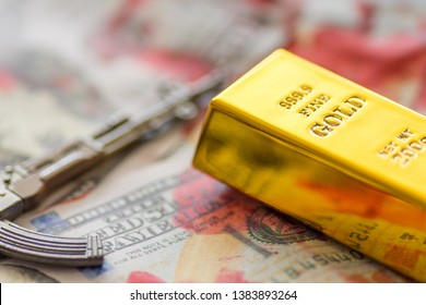 gold bar on blood stains on hundred dollar bills and ak47 replica traffic dirty gold concept