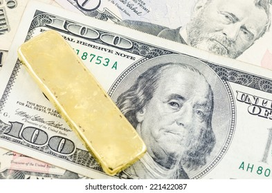 gold bar on the US dollar
