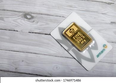 Gold bar produced by PT Aneka Tambang (Antam) and Indonesian rupiah (Jakarta, 02 June 2020)
