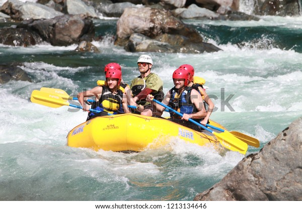 Gold Bar, Washington state, U.S.A, July 2018.  Family and guide white-water rafting the Skykomish River on a summer day.  The River's headwaters start in the Cascade Mountains of Washington State, USA